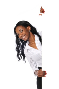 Young Black businesswoman with blank sign