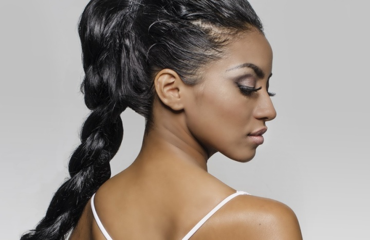 Beautiful exotic young woman profile braided hair